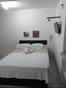 A bed or beds in a room at Studio Boa Viagem