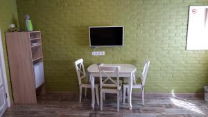 Телевизор и/или развлекательный центр в Guest House Na Svetloy