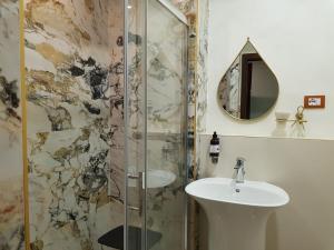Um banheiro em Hotel Il Convento