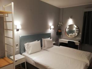 A bed or beds in a room at Abc Hotel