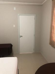 A bed or beds in a room at New Citi Hotel Ijui
