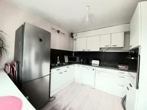 Cuisine ou kitchenette dans l'établissement Ma maison à Noyon, en pleine nature