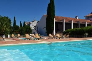 The swimming pool at or near Pousada Convento de Vila Viçosa