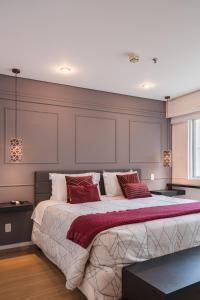 Cama ou camas em um quarto em Cyclinn Vila Olímpia
