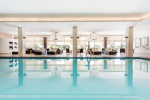 The swimming pool at or near Four Seasons Hotel Ritz Lisbon