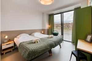 A bed or beds in a room at Stayokay Maastricht