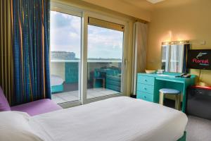 A bed or beds in a room at Floreal Blankenberge