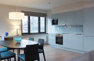 A kitchen or kitchenette at Thon Hotel Slottsparken