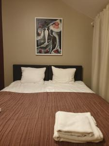 A bed or beds in a room at Resort Hotel Norppa
