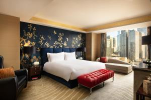 A bed or beds in a room at Fairmont Beijing