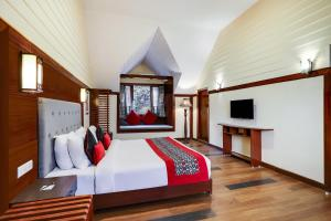 A bed or beds in a room at Summit Golden Crescent Resort & Spa