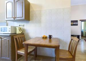 A kitchen or kitchenette at Apartment on Luiteranska Street 3 -61-TWO SEPARATE BEDROOM