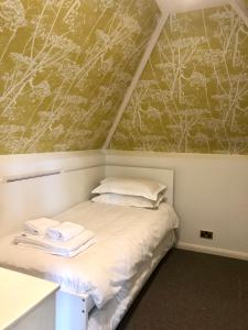 A bed or beds in a room at Trunkwell House Hotel