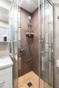 A bathroom at Arbat Apartment on Fokina 5