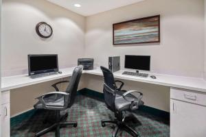The business area and/or conference room at La Quinta by Wyndham Fort Myers Airport