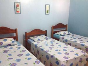 A bed or beds in a room at Refugio do Lobo
