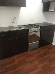 A kitchen or kitchenette at great location miraflores