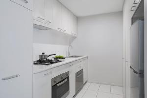 A kitchen or kitchenette at Mantra Midtown