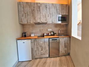 Una cocina o zona de cocina en Kiwidestiny Barcelona City