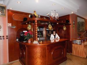 The lounge or bar area at Pensjonat Angela