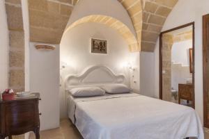 Letto o letti in una camera di Le Lantane - Luxury Rooms