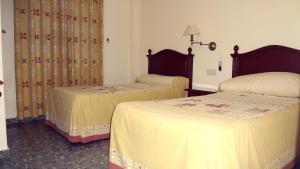 Cama o camas de una habitación en Hostal el Volao