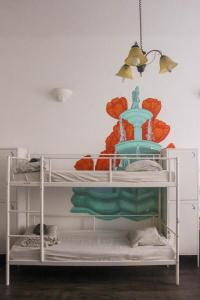 A bunk bed or bunk beds in a room at Grand Backpackers Students & Youth Hostel