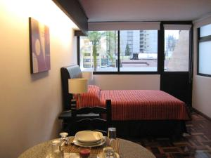 A bed or beds in a room at Suites Havre