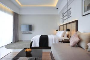 A bed or beds in a room at Sanctoo Suites & Villas