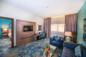 A seating area at MENA Plaza Hotel Albarsha