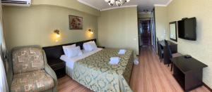 Кровать или кровати в номере Guest House AKS