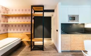 A bunk bed or bunk beds in a room at Ambiez Residencehotel