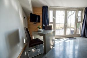 Телевизор и/или развлекательный центр в Posthoorn Lodge