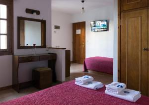 Ένα ή περισσότερα κρεβάτια σε δωμάτιο στο Drymna
