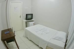 A bed or beds in a room at Grande Hotel