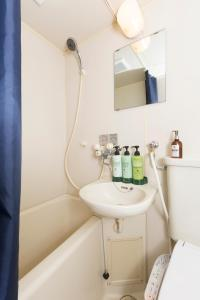 A bathroom at Residence Hotel Stripe Sapporo