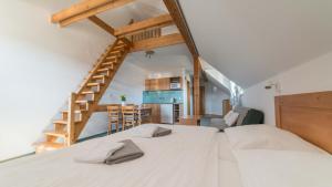 Postel nebo postele na pokoji v ubytování Penzion Horska Kvilda