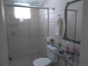 A bathroom at Apart Central Petit Vilage by MY HOME