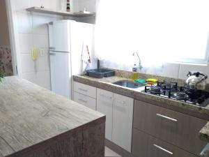 A kitchen or kitchenette at Apart Central Petit Vilage by MY HOME
