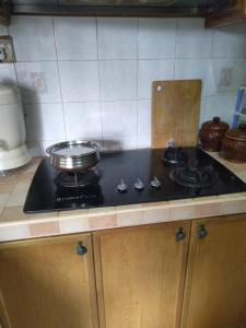 A kitchen or kitchenette at Awesome and Cost Efficient Homestay