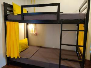 A bunk bed or bunk beds in a room at Best Bed Suvarnabhumi