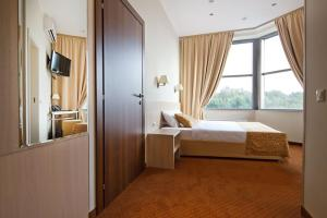 A bed or beds in a room at SkyPoint Hotel Sheremetyevo Airport