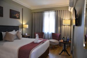 Cresta Jameson Hotelにあるベッド