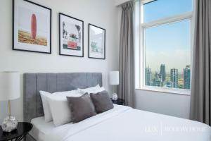A bed or beds in a room at LUX - The Dubai Marina Sea View Suite