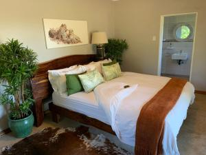 A bed or beds in a room at Benka LifeStyle