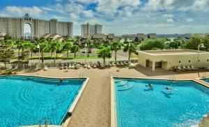 A view of the pool at Ariel Dunes II 1202 by RealJoy Vacations or nearby