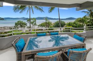 The swimming pool at or near Fully Renovated Frangipani Beach Front Apartments