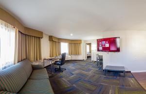 Ein Sitzbereich in der Unterkunft Buena Vista Motor Inn