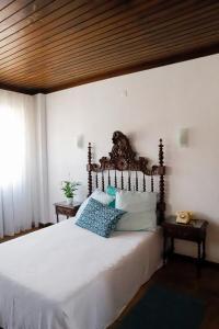Uma cama ou camas num quarto em Terrace House