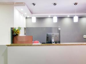 A cozinha ou cozinha compacta de OYO Hotel Pareto